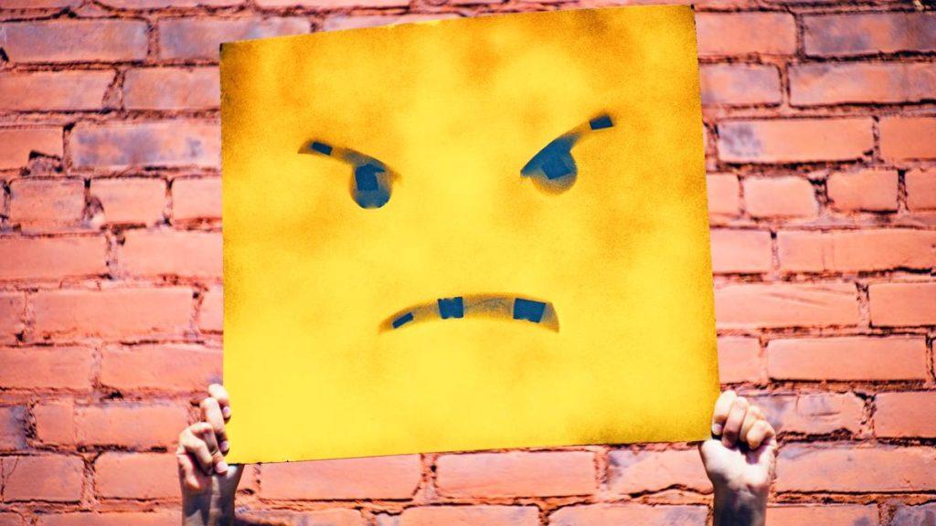 Mauer mit bösem Smiley